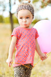 Cute baby girl with balloon outdoors Stock Photos
