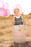 Cute baby girl with balloons outdoors Royalty Free Stock Images