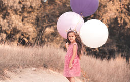 Cute baby girl with balloons outdoors Royalty Free Stock Photo