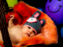 Cute baby girl in the basket Stock Photos