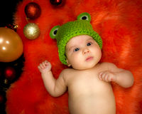 Cute baby girl in the basket Stock Images