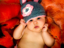 Cute baby girl in the basket Royalty Free Stock Images