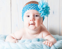 Cute baby girl with blue bandage Royalty Free Stock Images
