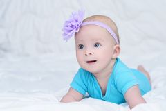 Portrait of cute little baby girl with bow flower on her head stock photos