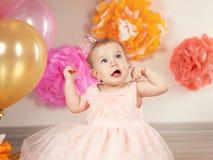 Cute baby girl celebrates birthday one year. Stock Photos