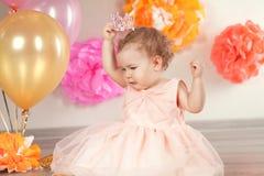 Cute baby girl celebrates birthday one year. Stock Photography
