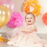 Cute baby girl celebrates birthday one year. Royalty Free Stock Image