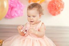 Cute baby girl celebrates birthday one year. Royalty Free Stock Photography