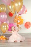 Cute baby girl celebrates birthday one year. Stock Photography