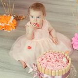 Cute baby girl celebrates birthday one year. Royalty Free Stock Photography