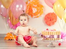 Cute baby girl celebrates birthday one year. Royalty Free Stock Photo