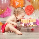 Cute baby girl celebrates birthday one year. Royalty Free Stock Images