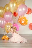 Cute baby girl celebrates birthday one year. Royalty Free Stock Photo