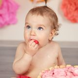 Cute baby girl celebrates birthday one year. Stock Photos