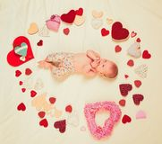 Cute baby girl. Childhood happiness.Valentines day. Love. Portrait of happy little child. Small girl among red hearts stock photos