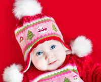 Cute baby girl in Christmas decorated knitted hat Stock Images