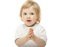 Cute baby girl clapping her hands stock images