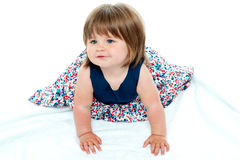 Cute baby girl crawling Royalty Free Stock Images