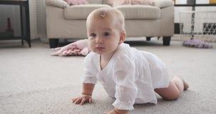 Cute baby girl crawling at home