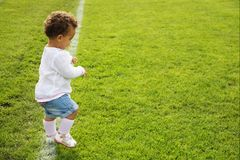 Cute baby girl doing her first steps Royalty Free Stock Image