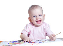 Cute baby girl draws paints Stock Photos