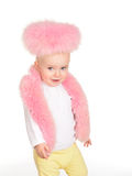Cute baby girl dressed in pink fur play on white background Royalty Free Stock Photography