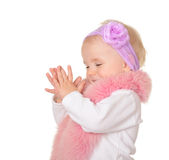Cute baby girl dressed in pink fur on white background Royalty Free Stock Image