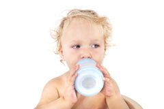 Cute baby girl drinking milk. Stock Photo