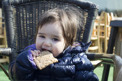 Cute baby girl eat a cookie Royalty Free Stock Image