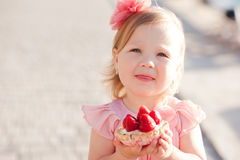 Cute baby girl eating cake Royalty Free Stock Photography