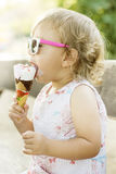 Cute baby girl eating ice cream Royalty Free Stock Images