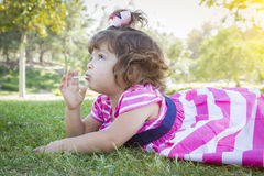 Cute Baby Girl Enjoying Lollipop Outdoors Royalty Free Stock Photos