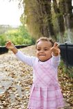 Cute baby girl excited among autumn leaves Royalty Free Stock Photography