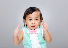Cute baby girl finger raised up Royalty Free Stock Photo