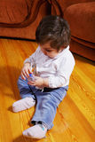 Cute baby girl on floor Stock Images