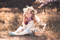Cute baby girl with flowers outdoors Royalty Free Stock Images