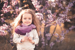 Cute baby girl with flowers Stock Photo