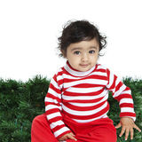 Cute Baby Girl in front of an Xmas Background Stock Images