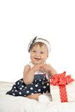 Cute baby girl with gift Royalty Free Stock Photos