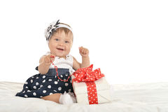 Cute baby girl with gift Royalty Free Stock Image