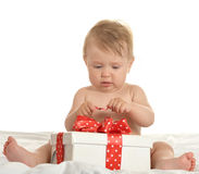 Cute baby girl with gift Stock Image