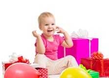 Cute baby girl with gifts and balloons on white background royalty free stock images