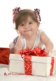 Cute baby girl  with gifts Stock Photos
