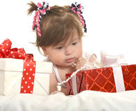 Cute baby girl  with gifts Stock Photography