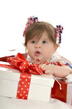 Cute baby girl  with gifts Stock Image