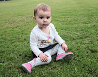 Cute baby girl on green grass Royalty Free Stock Photography
