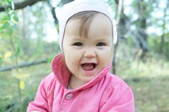 Cute baby girl happy smiling portrait. Adorable emotional child outdoor royalty free stock photos