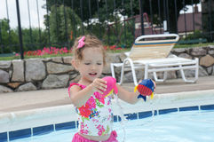 Cute baby girl is having fun in the pool Stock Images