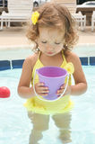 Cute baby girl is having fun in the pool Royalty Free Stock Photos