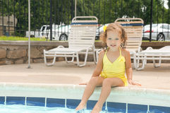 Cute baby girl is having fun in the pool Stock Photos